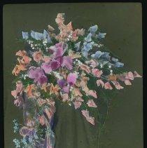 Image of Lantern slide, color, of a floral arrangement on stand, used for promotional display in Hoboken, no date, ca. 1920. - Transparency, Lantern-slide