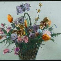 Image of Lantern slide, color, of a floral arrangement in basket, used for promotional display in Hoboken, no date, ca. 1920. - Transparency, Lantern-slide
