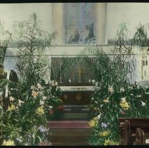 Image of Lantern slide, color, of a church interior with floral decorations, used for promotional display in Hoboken, no date, ca. 1920. - Transparency, Lantern-slide