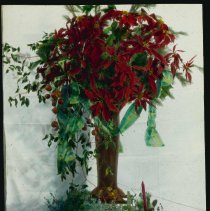 Image of Lantern slide, color, of a Christmas centerpiece with candle, used for promotional display in Hoboken, no date, ca. 1920. - Transparency, Lantern-slide