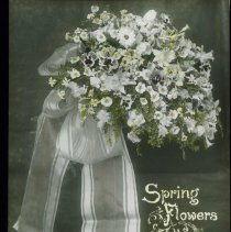 """Image of Lantern slide, color, of a bridal bouquet, captioned """"Spring Flowers for the Bridesmaid,"""" used for promotional display in Hoboken, no date, ca. 1920. - Transparency, Lantern-slide"""