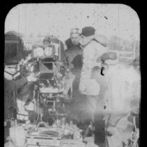 """Image of Color slide of a camera set-up with crew on pier set of the motion picture """"On the Waterfront"""", Hoboken, no date, ca. late 1953-early 1954. - Transparency, Slide"""