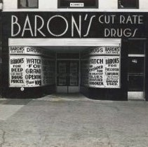 Image of B+W photo of the storefront of Baron's Drugstore, Hoboken, November, 1939. - Print, Photographic