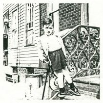 Image of Black-and-white photocopy of photo of Wayne Ratti on the front steps of 721 Adams St., Hoboken, 1950. - Print, Photographic