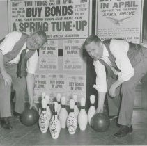 "Image of B+W photo of two Hudson County men at a bowling alley where caricatures of ""Hitler & Co."" were painted on pins, no place (Hudson County), [1943]. - Print, photographic"