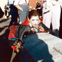 """Image of Color photo of the 1985 Hoboken Ragamuffin Parade with a child in vampire costume in a """"coffin car"""", Hoboken, October, 1985. - Print, Photographic"""