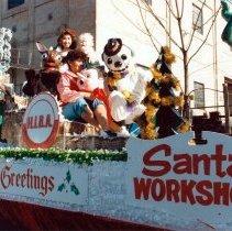 Image of Color photo of the Hoboken Industrial & Business Assn. Santa's Workshop float for 1985 Hoboken Ragamuffin Parade, Hoboken, October, 1985. - Print, Photographic
