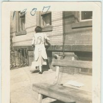 Image of B+W photo of a Mrs. McNamara on street in front of building, location not known, Hoboken, September, 1937. - Print, Photographic