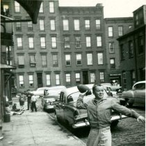 Image of B+W photo of Tommy Duff throwing a football on Willow Terrace, Hoboken, no date, [1959]. - Print, Photographic
