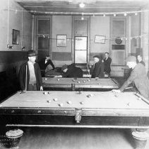 Image of Sepia-tone group photo of men playing billiards or pool at the Hoboken YMCA, Hoboken, no date, ca. 1918-21. - Print, Photographic