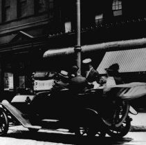 Image of B+W photo of an automobile, jitney autobus, on Hudson St. near Hudson Pl., 1915. - Negative, Film