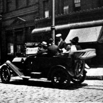 Image of B+W photo of an automobile, jitney autobus, on Newark St. near Hudson St., 1915. - Negative, Film