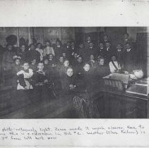 Image of folder 4, photo & caption