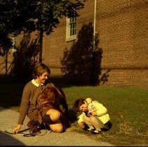 Image of Color photo negative of Mary Ann Samperi Soule and young girl, Patricia Soule, on Hudson St. near Davidson Lab, Hoboken, no date, circa 1971. - Negative, Roll Film