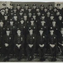 Image of Color copy photo of a B+W group photo of the Hoboken Police Department, Hoboken, no date, ca. 1950's. - Print, photographic