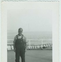 Image of B+W photo of  Charlie Kosbab on an upper deck of an unidentified vessel, no date, ca. 1965-70. - Print, Photographic