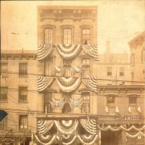Image of Sepia-tone photo of decoration by United Decorating on 112 Hudson St. Hoboken, n.d., ca. 1900-1910. - Print, Photographic