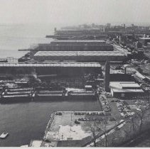 Image of Reference image of printed photo image of aerial view of waterfront looking south from pg 29 of archives catalog 2002.026.0002, Hoboken, ca. 1975. - Print, Photographic