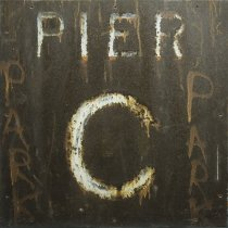 "Image of Rusted metal sign ""Pier C"" from the 4th street gatehouse of the Hoboken Piers. - Sign"
