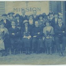 Image of Cyanotype print of a group of men and women seated outside a church or mission building, no place [Hoboken], no date, ca. 1900-1910. - Print, Photographic