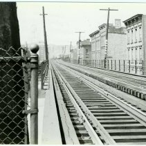 Image of B+W copy photo of a view looking west from the eastbound elevated railway station at Henderson and Ferry Streets, Hoboken, 1948. - Print, Photographic