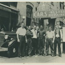 Image of B+W photo of 4 men on the sidewalk at the Model Garage, 214 Clinton St., Hoboken, no date, ca. 1935. - Print, Photographic