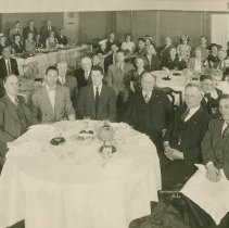 Image of B+W group photo of a dinner of the Brotherhood of Locomotive Firemen & Engineers honoring Charles F. Keenen, Hotel New Yorker, N.Y., May 30, 1947. - Print, Photographic