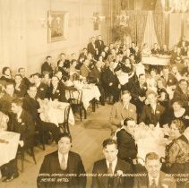 Image of Sepia-tone group photo of the Annual Dinner-Dance sponsored by the Hoboken Businessmen's Association, Meyers Hotel, Hoboken, April 18, 1934. - Print, Photographic
