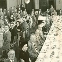 Image of B+W group photo of the testimonial dinner for Harry D. Bingham by his co-workers upon his retirement, Meyers Hotel, Hoboken, September 14, 1951. - Print, Photographic