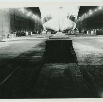Image of Group of 3 B+W photos with night views of drydock no. 4 at the Bethlehem Steel Shipyard, Hoboken Division, July 6, 1959. - Print, photographic