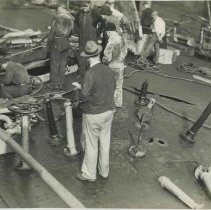 Image of B+W photo showing workers inspecting damage on the main deck on unidentified vessel at the Bethlehem Steel Shipyard, Hoboken Division, no date, ca. 19 - Print, Photographic