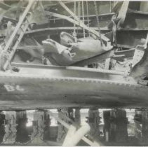Image of B+W photo of exterior view of hull plate and structural repairs underway on unidentified vessel at the Bethlehem Steel Shipyard, Hoboken Division, no - Print, Photographic