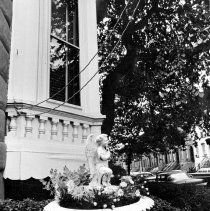 Image of B+W photo of a cast-iron urn planter with an angel sculpture at 169 11th St., southeast corner of Garden & 11 Sts., Hoboken, no date (ca. 1968-72) - Print, photographic