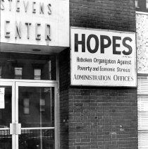 Image of B+W photo of the sign and entrance for the administrative offices of HOPES, 124 Jackson St., Hoboken, N.J., no date (ca. 1968-1972). - Print, photographic