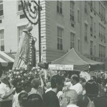 Image of B+W photo of the St. Ann's Feast procession of the Madonna passing the Hoboken Historical Museum's booth, Hoboken, July, 2000. - Print, Photographic