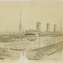 """Image of Sepia-tone photo of the """"Leviathan"""" docked at the Hoboken piers, Hoboken, September 20, 1920. - Print, Photographic"""