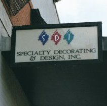 Image of Color photo of the sign of Specialty Decorating & Design, Inc., Building A, corner of 800 Jackson St.,  Hoboken, Jan. 3 & 4, 2002. - Print, Photographic