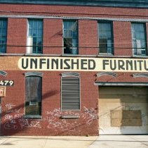 Image of Color photo of a painted wall sign, Unfinished Furniture, at 715 Grand St., Hoboken, Jan. 3 & 4, 2002. - Print, Photographic