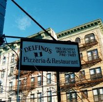Image of Color photo of hanging sign for Delfino's Pizzeria & Restaurant, corner of 5th & Jefferson Sts., Hoboken, Jan. 3 & 4, 2002. - Print, Photographic