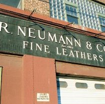 Image of Color photo of a wall sign for R. Neumann & Co., Est. 1883, Fine Leathers, 300 Observer Highway, Hoboken, Jan. 3 & 4, 2002. - Print, Photographic