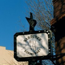 Image of Color photo of hanging sign for Nardine's Restaurant, 615 First St. at Jackson Street, Hoboken, Jan. 3 & 4, 2002. - Print, Photographic