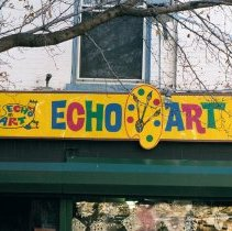 Image of Color photo of hanging sign for Hoboken Furniture and wall sign for Echo Art, 157 First Street, Hoboken, Jan. 3 & 4, 2002. - Print, Photographic