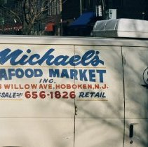 Image of Color photo of a delivery truck sign for Michael's Seafood Market, Inc., 226 Willow Avenue, Hoboken, Jan. 3 & 4, 2002. - Print, Photographic