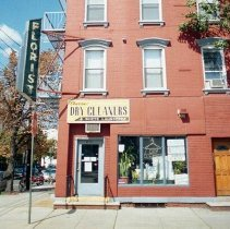 Image of Color photo of sign and storefront for Classic Cleaners, 364 Sixth Street and a Florist sign, Hoboken, Sept., 1-5, 2001. - Print, Photographic