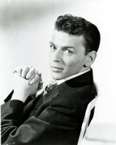Image of Black-and-white photo of a young Frank Sinatra in a dark jacket & tie, no place, no date, ca. 1945. - Print, Photographic
