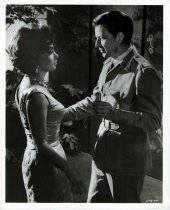 """Image of Black-and-white photo, movie still, of Frank Sinatra & Gina Lollabrigida from film """"Never So Few"""", no place, no date, ca. 1959-60. - Print, Photographic"""