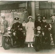 Image of Color copy photo of a B&W photo of two motorcycle patrolmen with a nurse to the right of Rex's Beer Garden exterior, Hoboken, no date, ca. 1925. - Print, Photographic