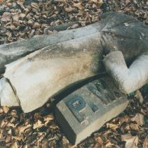 Image of Digital image of color photo of a broken torso from the cemetery monument for Peter Woodward, Jersey City, N.J., Nov. 2002. - Print, Photographic