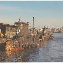 Image of Digital image of postcard of two Erie-Lackawanna tugboats docked at the Hoboken Terminal, Hoboken, Feb. 1974. - Postcard