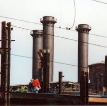 Image of Digital image of color photo of the roof edge and smokestacks of the former Hudson & Manhattan Rail Road powerhouse, Jersey City, May, 2001. - Print, Photographic